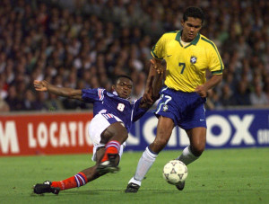 Giovanni of Brazil (R) avoids the tackle of French defender Marcel Desailly in their friendly soccer..